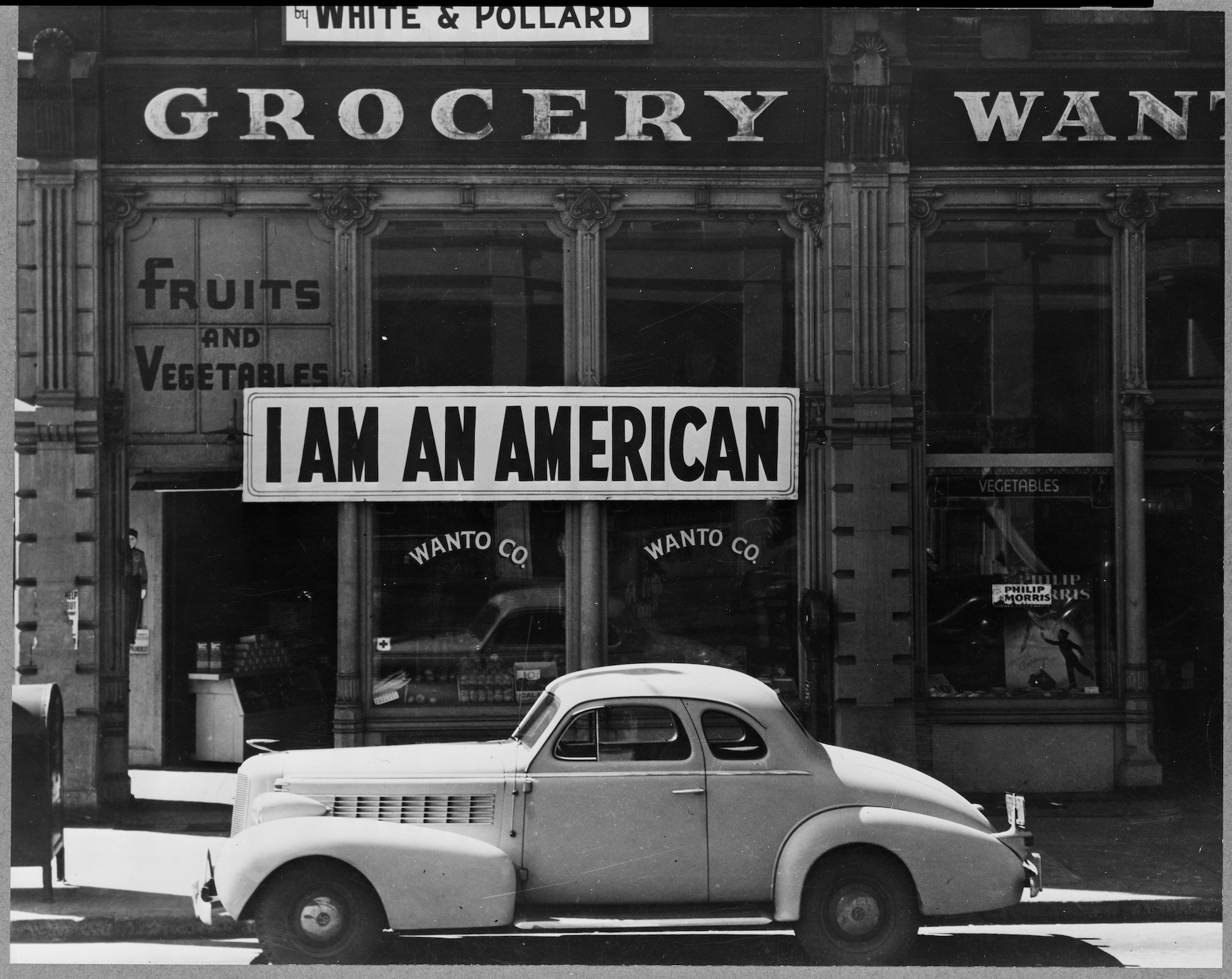 """I Am An American"" – sign placed by a Japanese-American shop owner"
