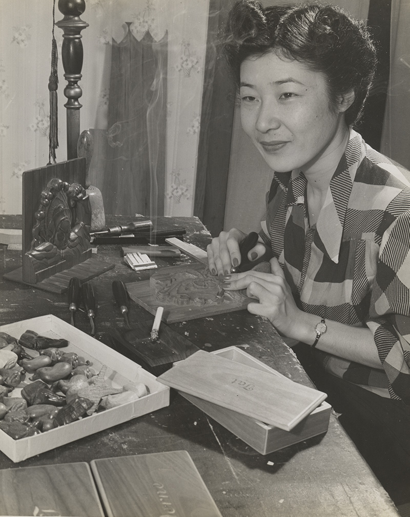 Tatsuko Shinno, wood carver, was relocated to Des Moines from Jerome Relocation Center. | Hikaru Iwasaki, courtesy of Japanese American National Museum (Identifier 2015.100.235a) ABs10 MMD