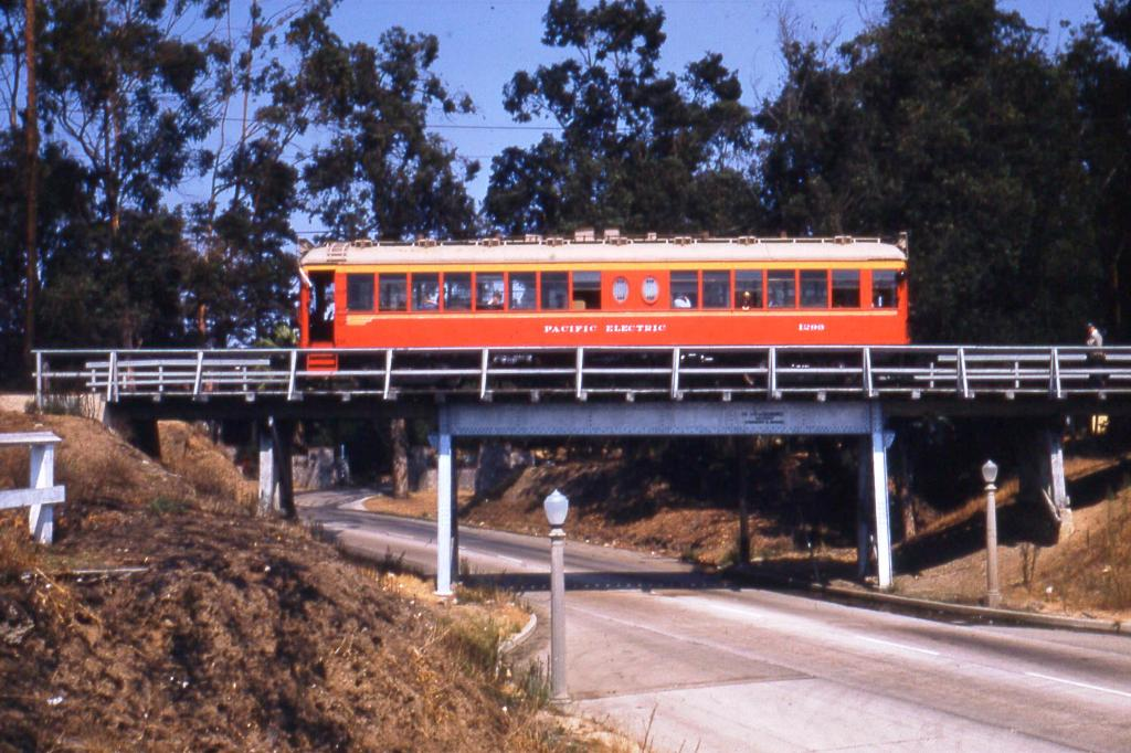 A Red Car traveling on the Santa Monica Air Line crosses over Motor Avenue. Photo by Alan Weeks, courtesy of the Metro Transportation Library and Archive.