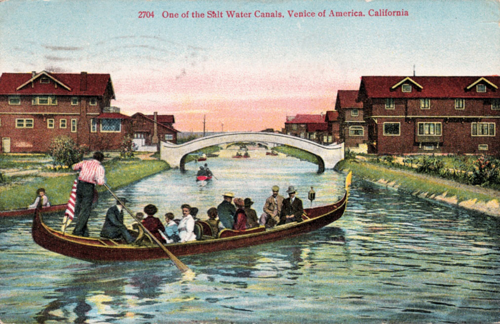 A gondolier rows through one of Venice of America's original canals, now a paved roadway. Courtesy of the Metro Transportation Library and Archive.