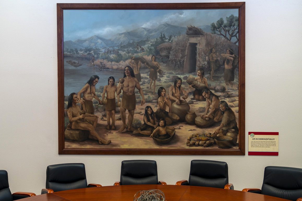 A painting representing Chemehuevi Valley village life in the conference room of the Chemehuevi Cultural Center, Havasu Lake, CA. Photo: Kim Stringfellow.