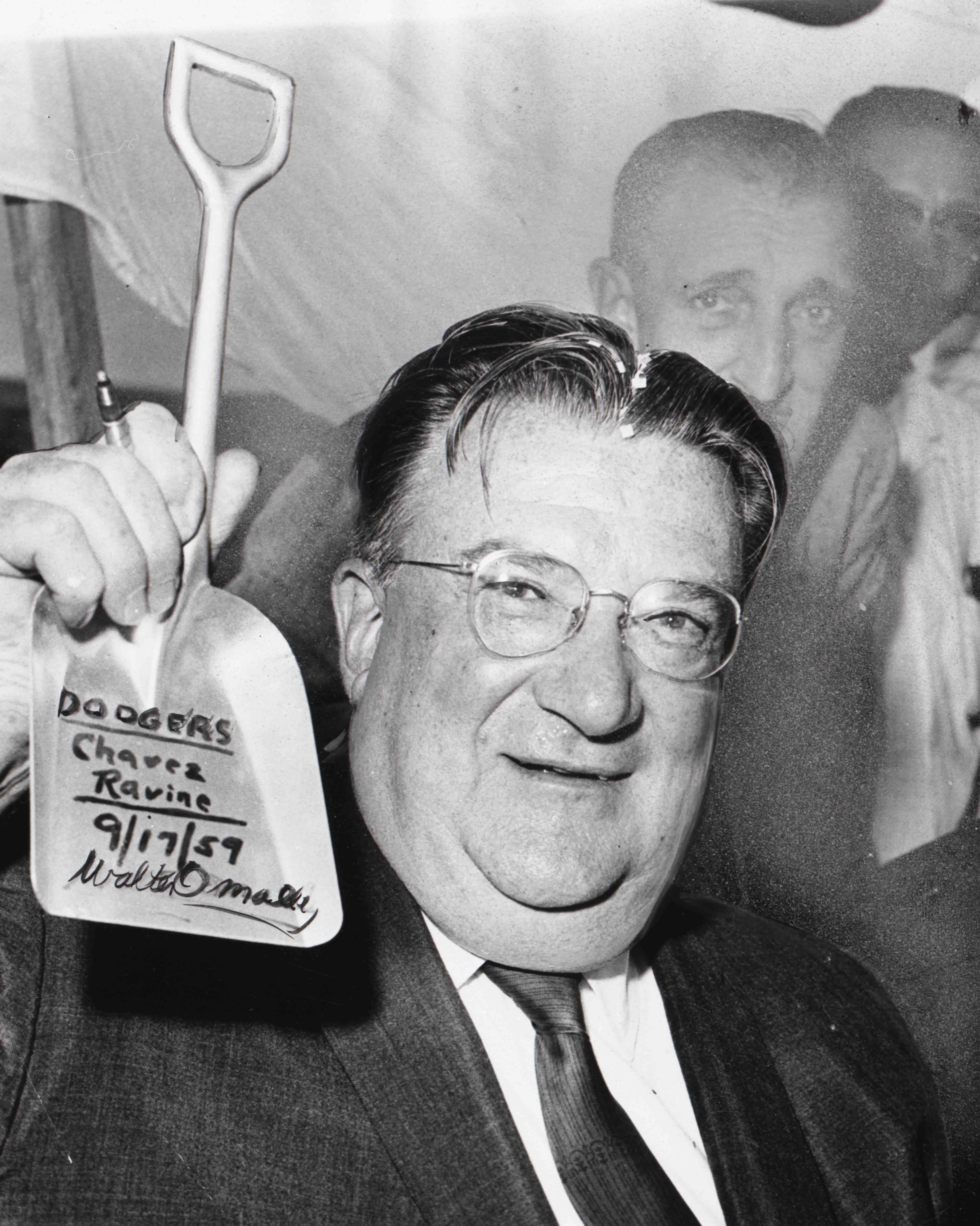 Former owner of the Dodgers Walter O'Malley with his shovel. LA Herald Examiner Photo Collection, Los Angeles Public Library
