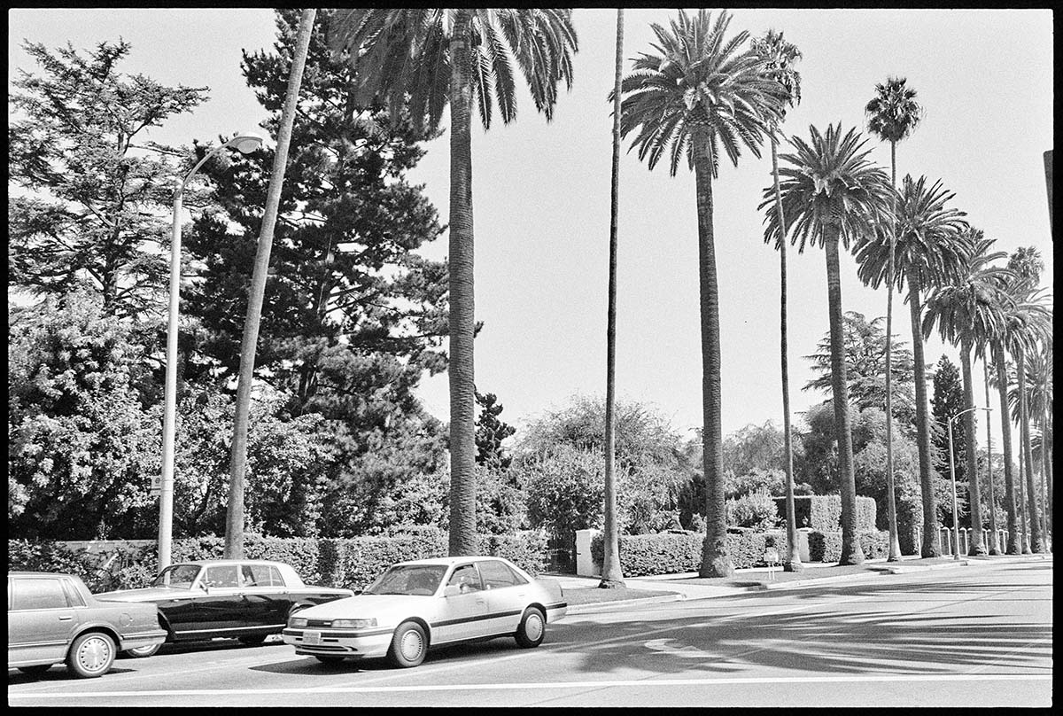 Sunset Blvd. at N. Beverly Dr., 1990, Ed Ruscha. | Part of the Streets of Los Angeles Archive, The Getty Research Institute, 2012.M.1. © Ed Ruscha