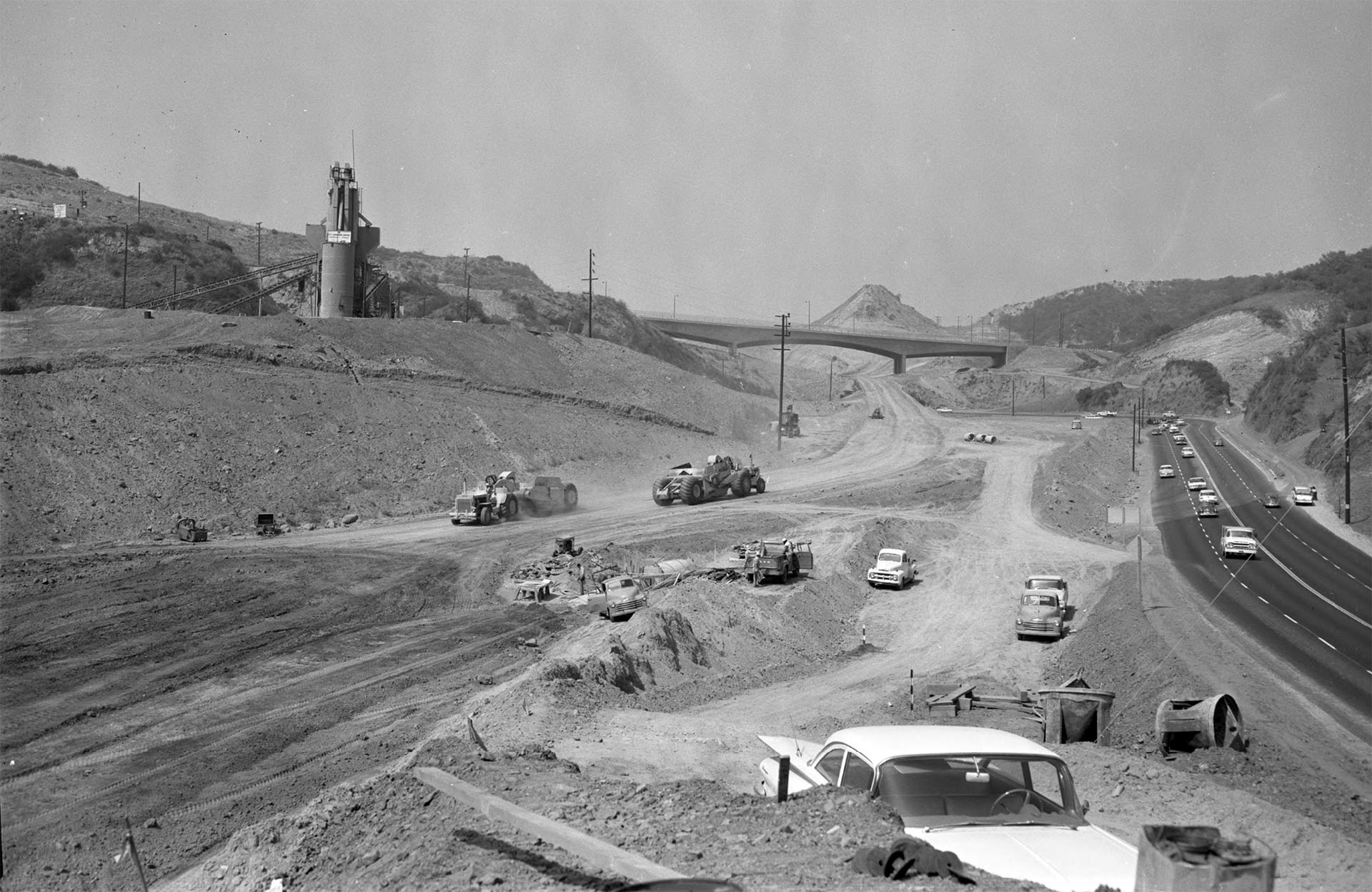 Grading work on section of San Diego Freeway running across Santa Monica Mountains, Calif., 1961