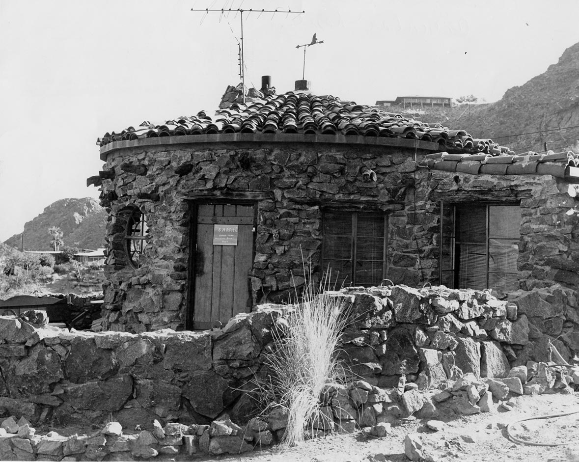 "The former home of architect R. Lee Miller. The sign on the door says: ""Shanti. Enter with Primitive Bare Feet."" 