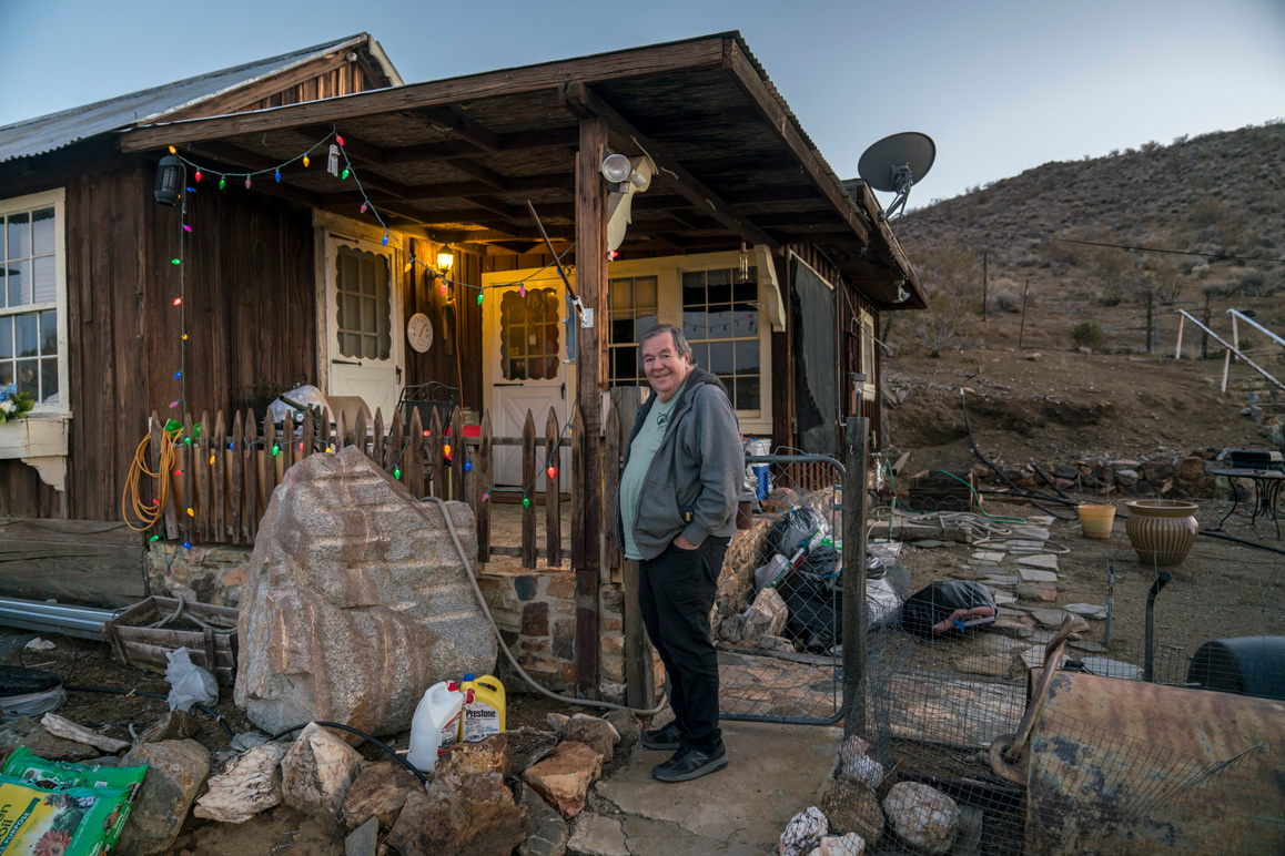 "Retired miner Tom O'Donnell, a.k.a. ""Ordinary Tom"" in front of his historic home in Randsburg, California. 