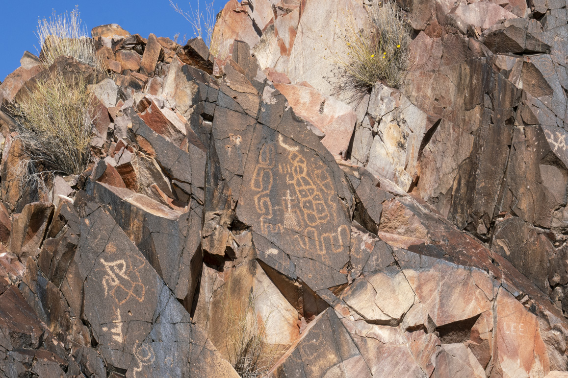 Matt Leivas, Sr. interprets this ancient petroglyph at the center of the photo as the map of the Lake Havasu region before colonization. Photo: Kim Stringfellow.