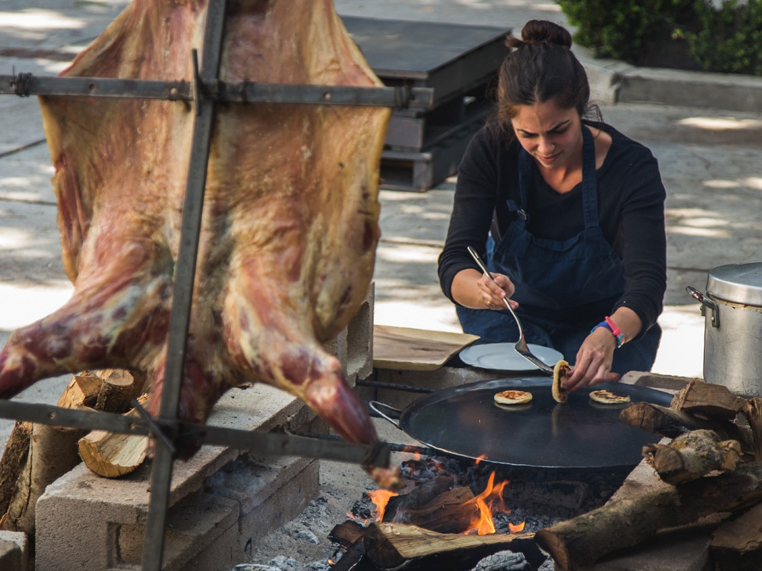 Chef Debbie Michail performing whole animal roast