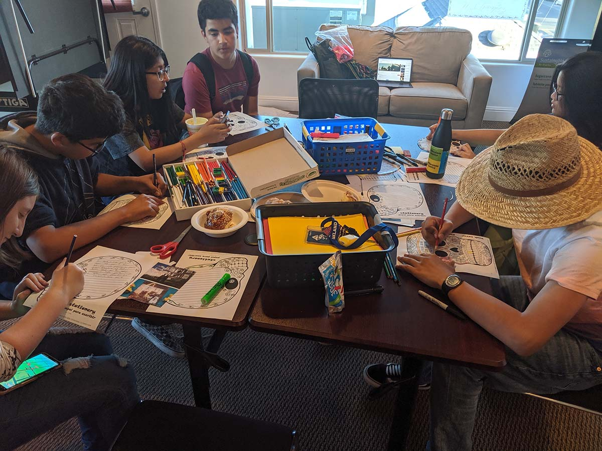 Californians for Justice leaders writing to loved ones that have passed away for Dias de Los Muertos. | Californians for Justice