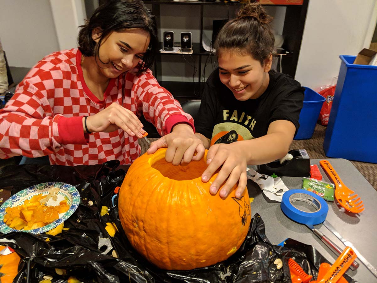 Storytelling and artistic self-expression is also a staple of healing. Californians for Justice leaders at the annual Halloween social carving a pumpkin. | Californians for Justice