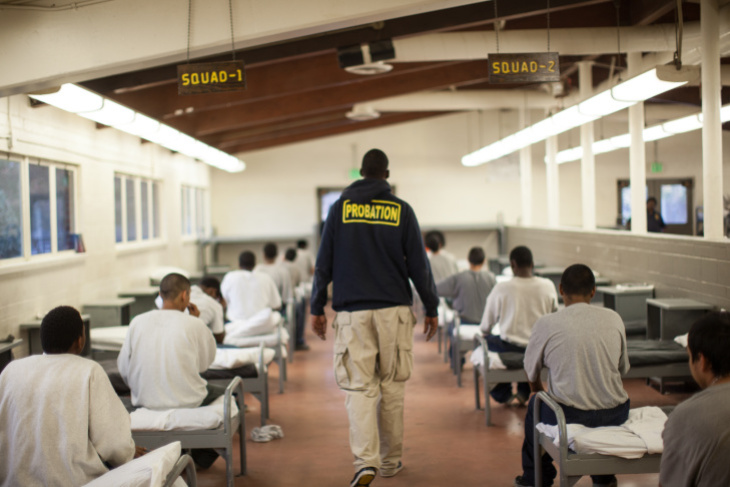 A probation officer walks through a dormitory at Camp Afflerbaugh in 2013. | Grant Slater / KPCC