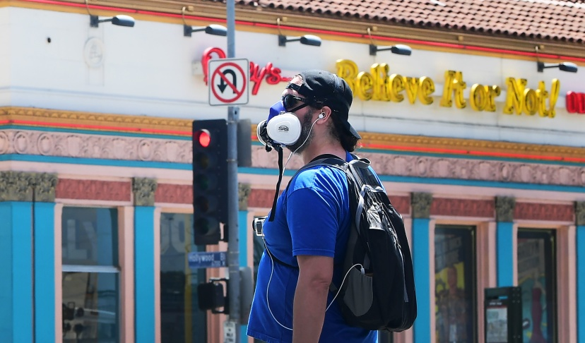 A pedestrian in a facemask walks in Hollywood, California on April 23.   Frederic J. Brown/AFP via Getty Images