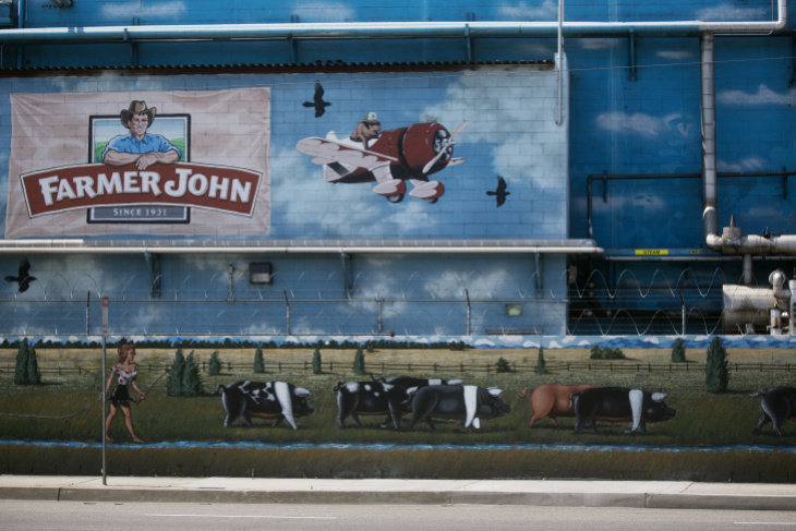 The mural on the wall of the Farmer John meatpacking facility in Vernon. (Maya Sugarman/KPCC)