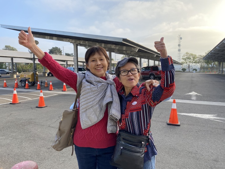 Trinh Luu (left) from Tustin and her sister, Anh Luu (right) from Stanton, arrived at the Orange County Registrar's office this morning at 6:30 a.m. | Jill Replogle/LAist