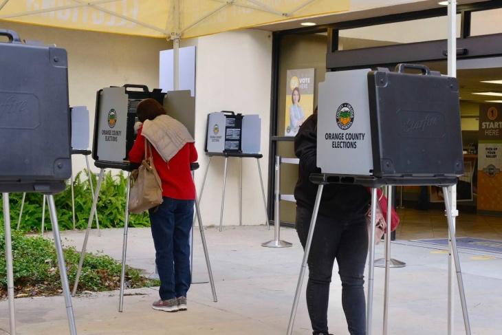 People vote at the O.C. Registrar. | Chava Sanchez/LAist