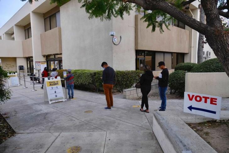 People wait in line to vote at the O.C. Registrar. | Chava Sanchez/LAist