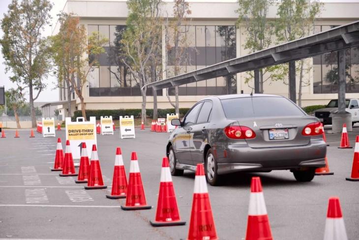 Cars wait in line for drop-off mail-in voting. | Chava Sanchez/LAist