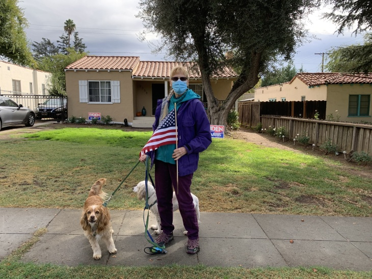 Barbara Wilson walked with the American flag around her Altadena neighborhood after the race was called for Joe Biden. | Josie Huang/LAist