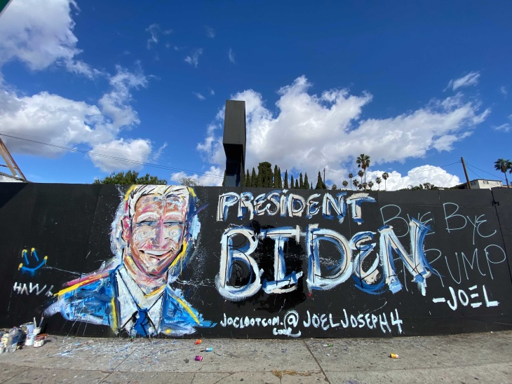 A mural of Joe Biden quickly went up in Echo Park on Saturday, Nov. 7 after he was declared the winner of the 2020 presidential election. | Gina Pollack/LAist