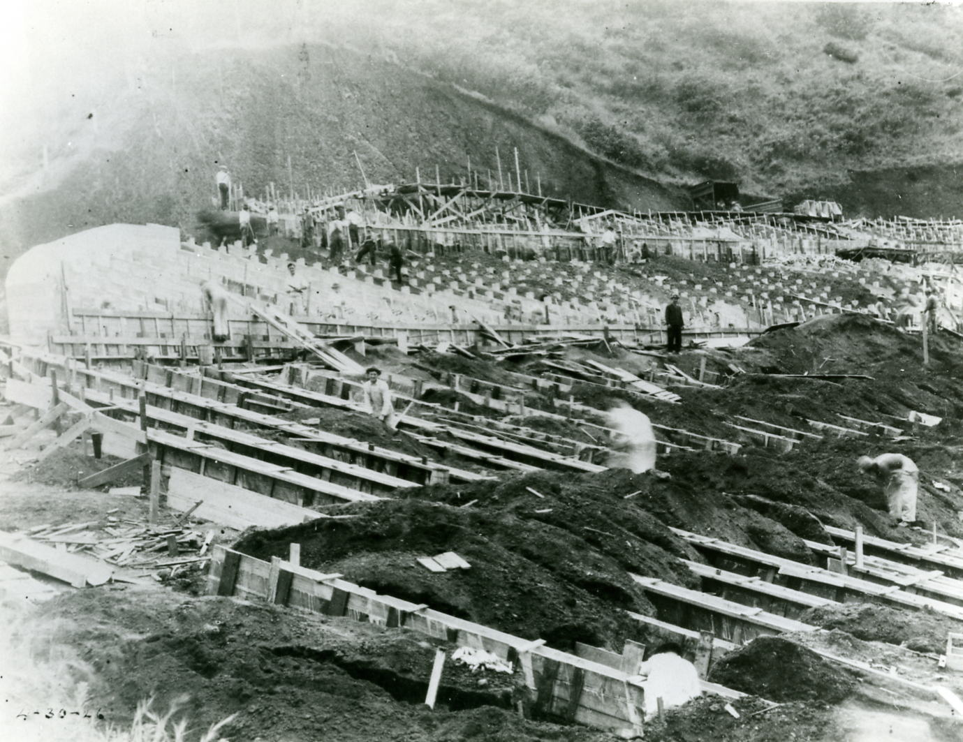 Workers scattered across construction area for installation of benches at the Hollywood Bowl, April 30, 1926. | Los Angeles Philharmonic Archives