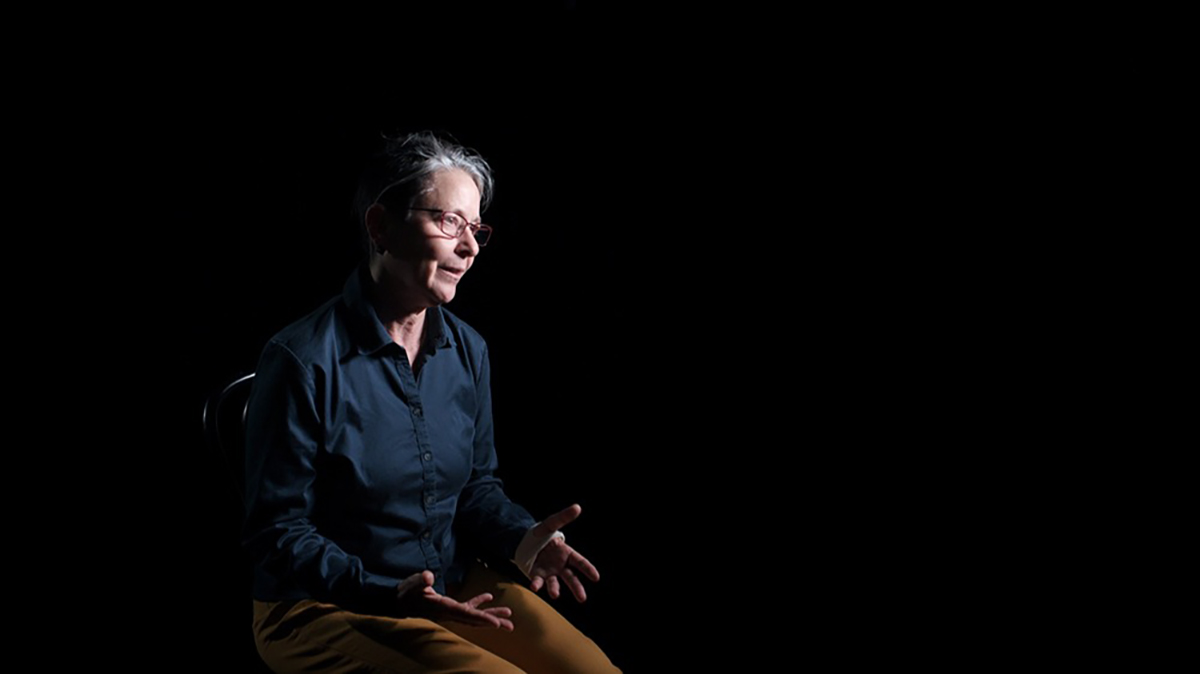 Victoria Marks sits in front of a black background. | Courtesy of Victoria Marks and UCLA