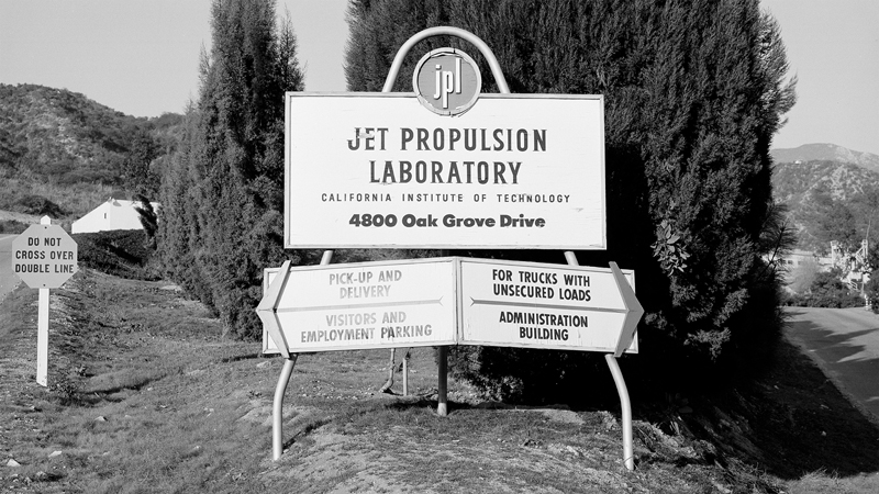 Then: JPL entrance in 1957. Since then, the official lab sign has been moved south. Now: JPL entrance in 2016. | NASA/JPL-Caltech
