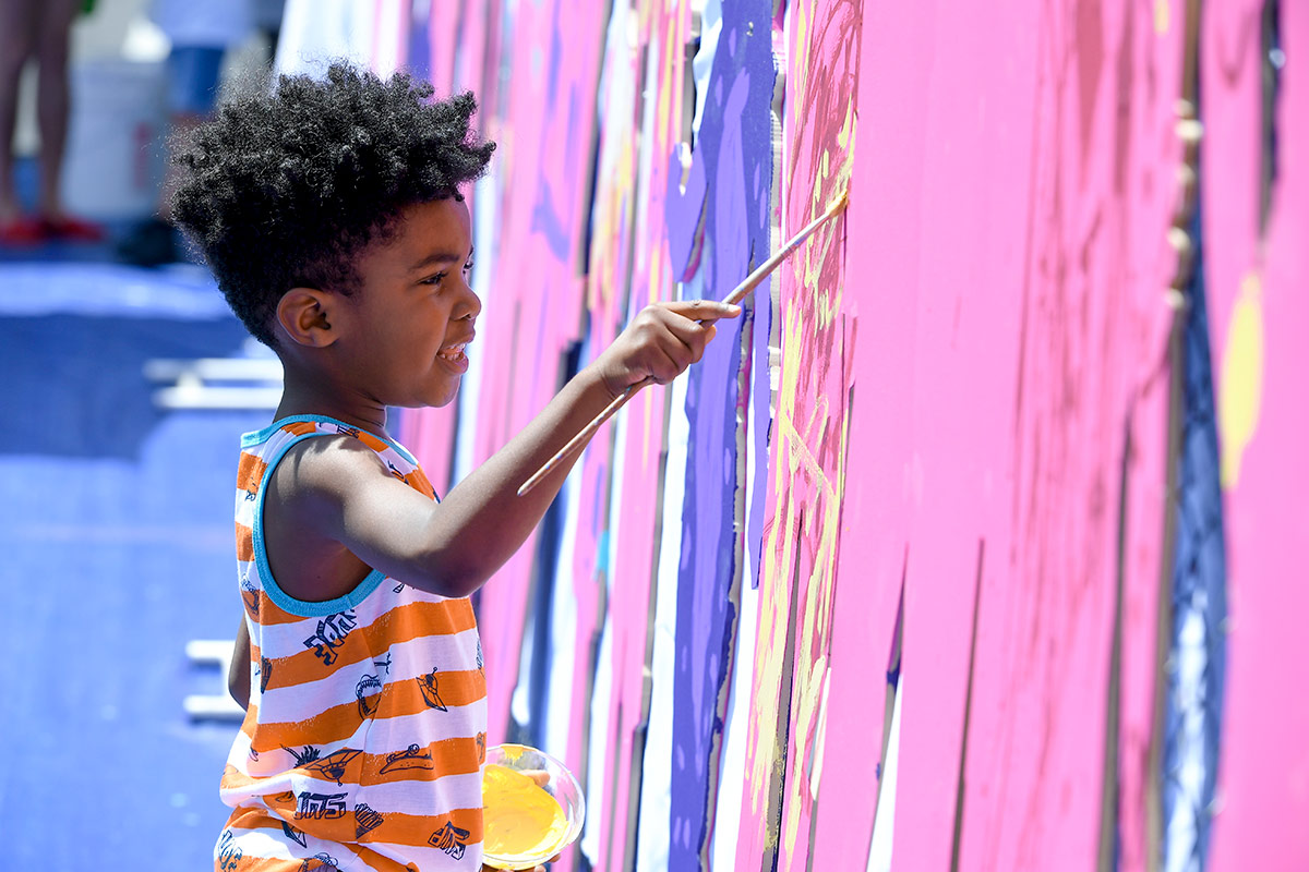 A young aspiring artist enjoys the chance to paint away during the reopening of The Music Center's newly renovated plaza during The Music Center's Splish Splash Plaza Bash. | Courtesy of The Music Center.