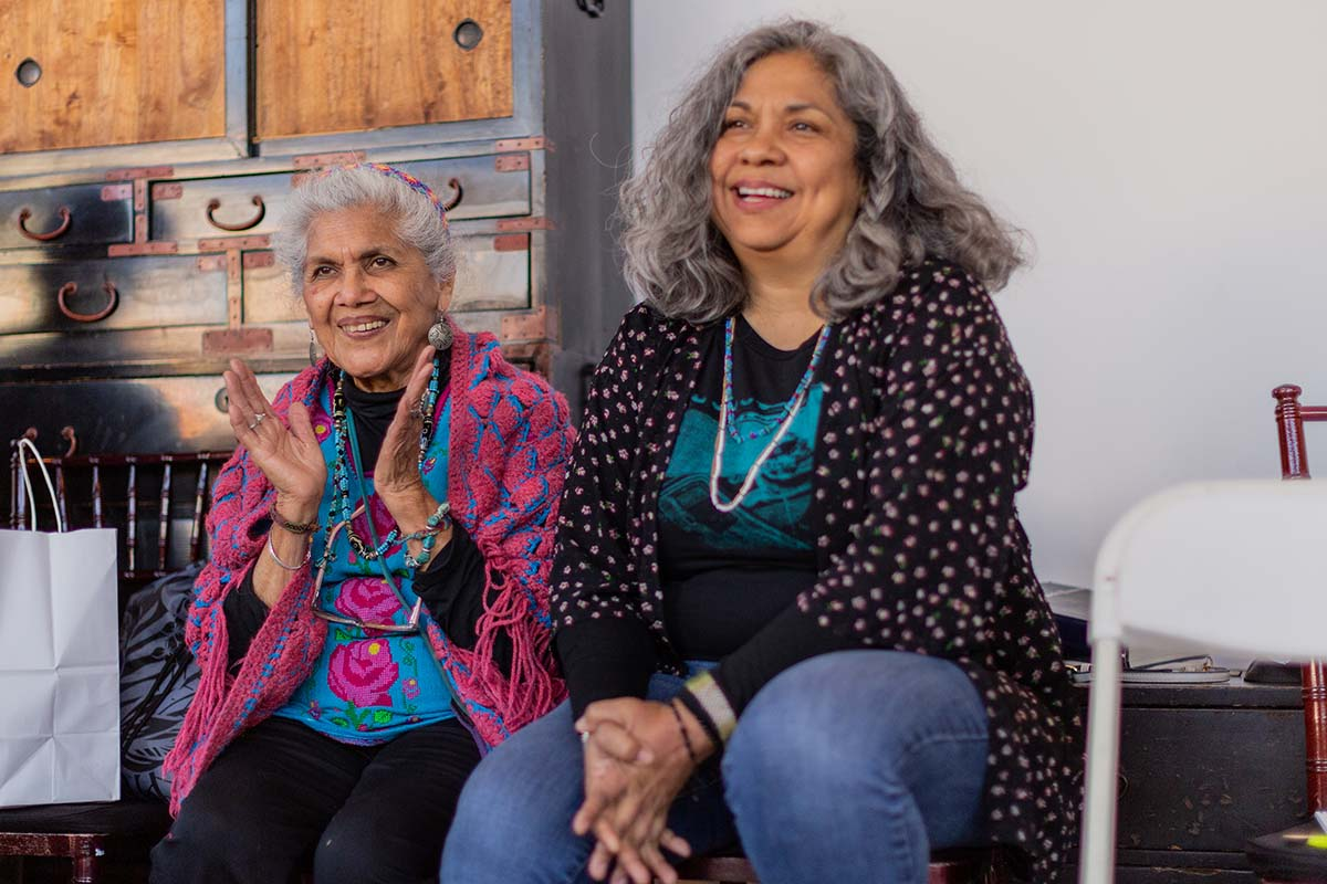 """Ofelia Esparza (L) and her daughter Rosanna Esparza Ahrens (R) speak on the topic of art and social change at a Traditional Arts Roundtable Series event called """"Theories of Change and Transformative Cultural Practice"""" 