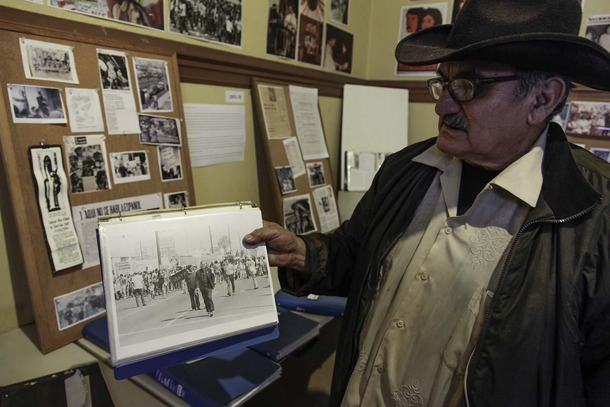 Historian Rosalio Muñoz showing archival photo of Fr. Luce at a protest event | Courtesy of Ravi GuneWardena La Raza AB s9