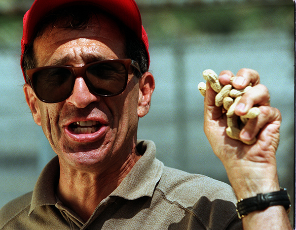 Richard Aller, peanut vendor, holds a fistful of roasted nuts | Photo by Kirk McKoy/Los Angeles Times via Getty Images