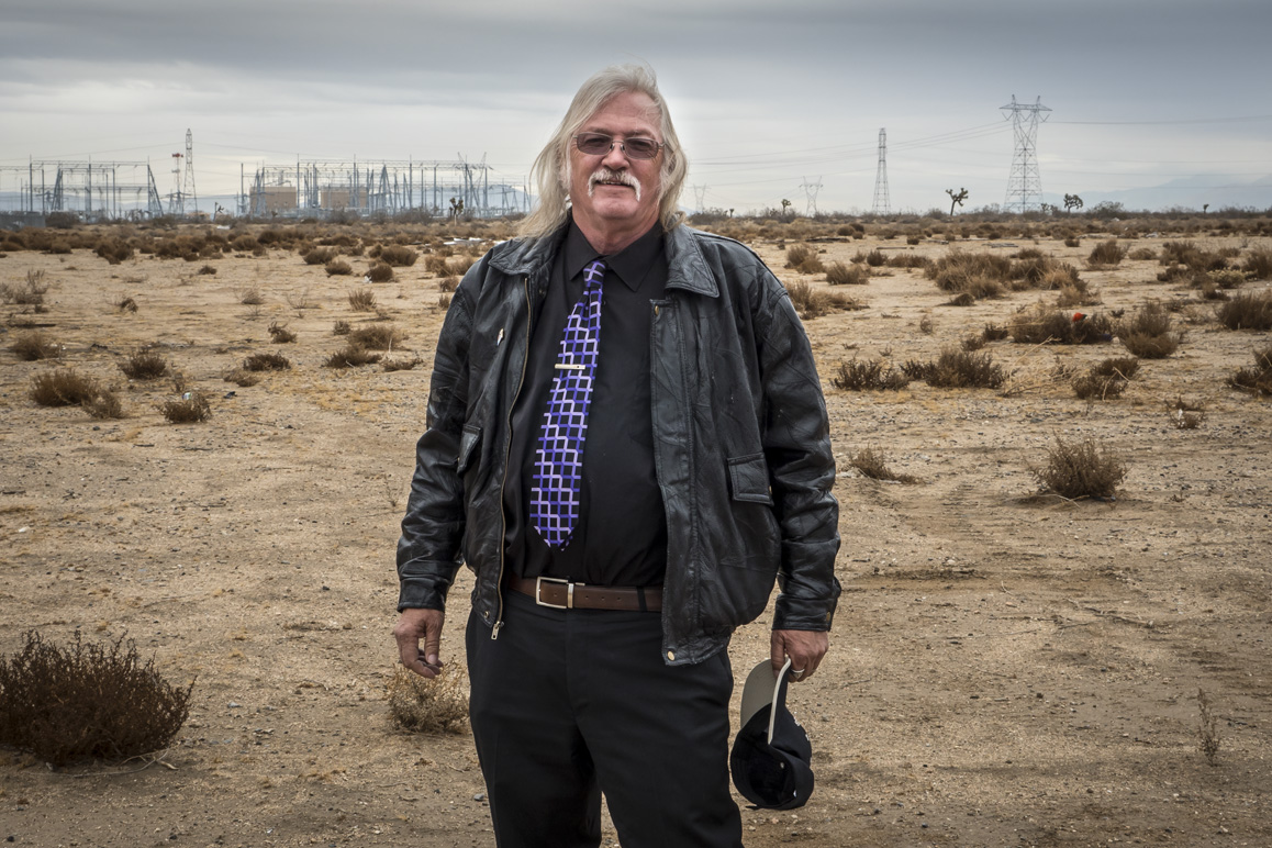 "Adelanto councilman John ""Bug"" Woodard standing in front of soon-to-be developed land within the commercial cannabis cultivation zone. Photo: Kim Stringfellow."