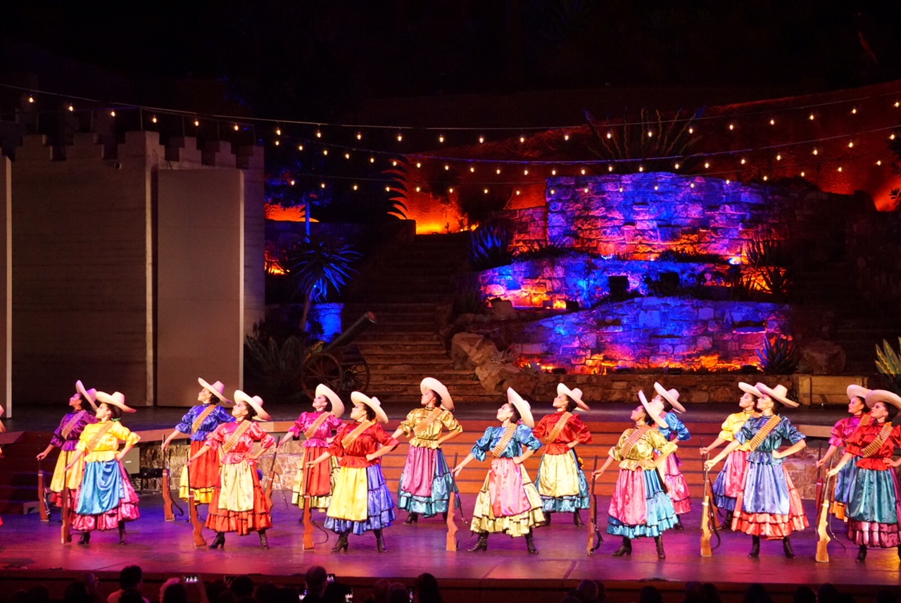 """""""La Adelita"""" performed by Pacifico Dance Company showcases the role of women int he Mexican Revolution. Female dancers with sombreros and and guns stand proudly in formation. 