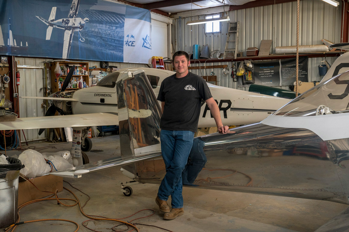 Scaled Composites test pilot and engineer Zachary Reeder in his hangar with an experimental aircraft originally designed and built by Burt Rutan. | Kim Stringfellow