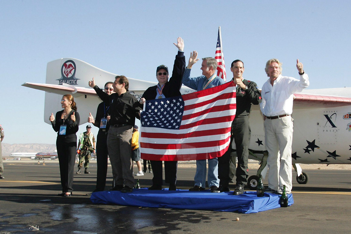 Celebrating the 2004 Ansari XPRIZE: Anousheh Ansari, [unidentified], Peter Diamandis, Paul Allen, Burt Rutan, Brian Binnie (pilot) and Richard Branson are pictured from left to right. | Courtesy of XPRIZE Foundation