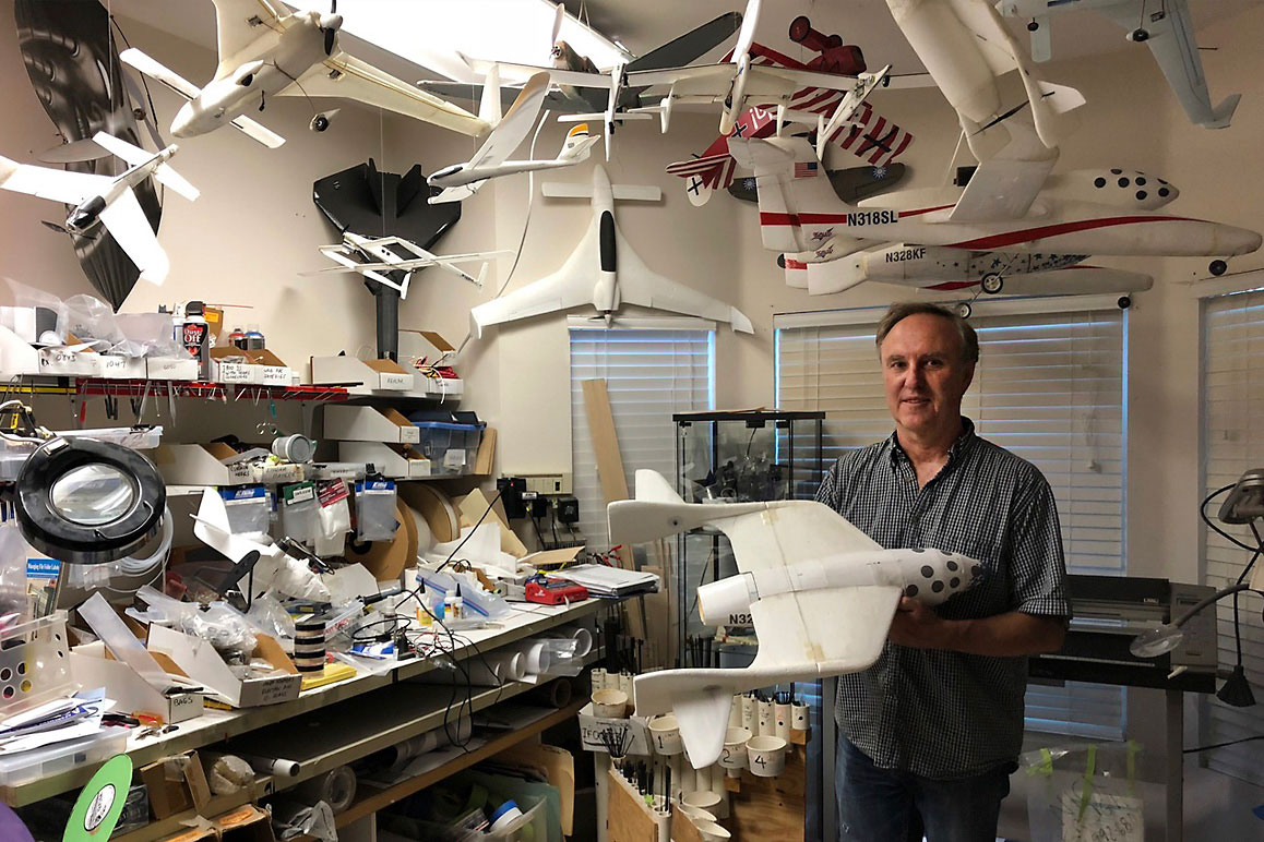 Dan Kreigh, a senior structural engineer at Scaled Composites, displays his scale model of SpaceShipOne. | Daniel Housman