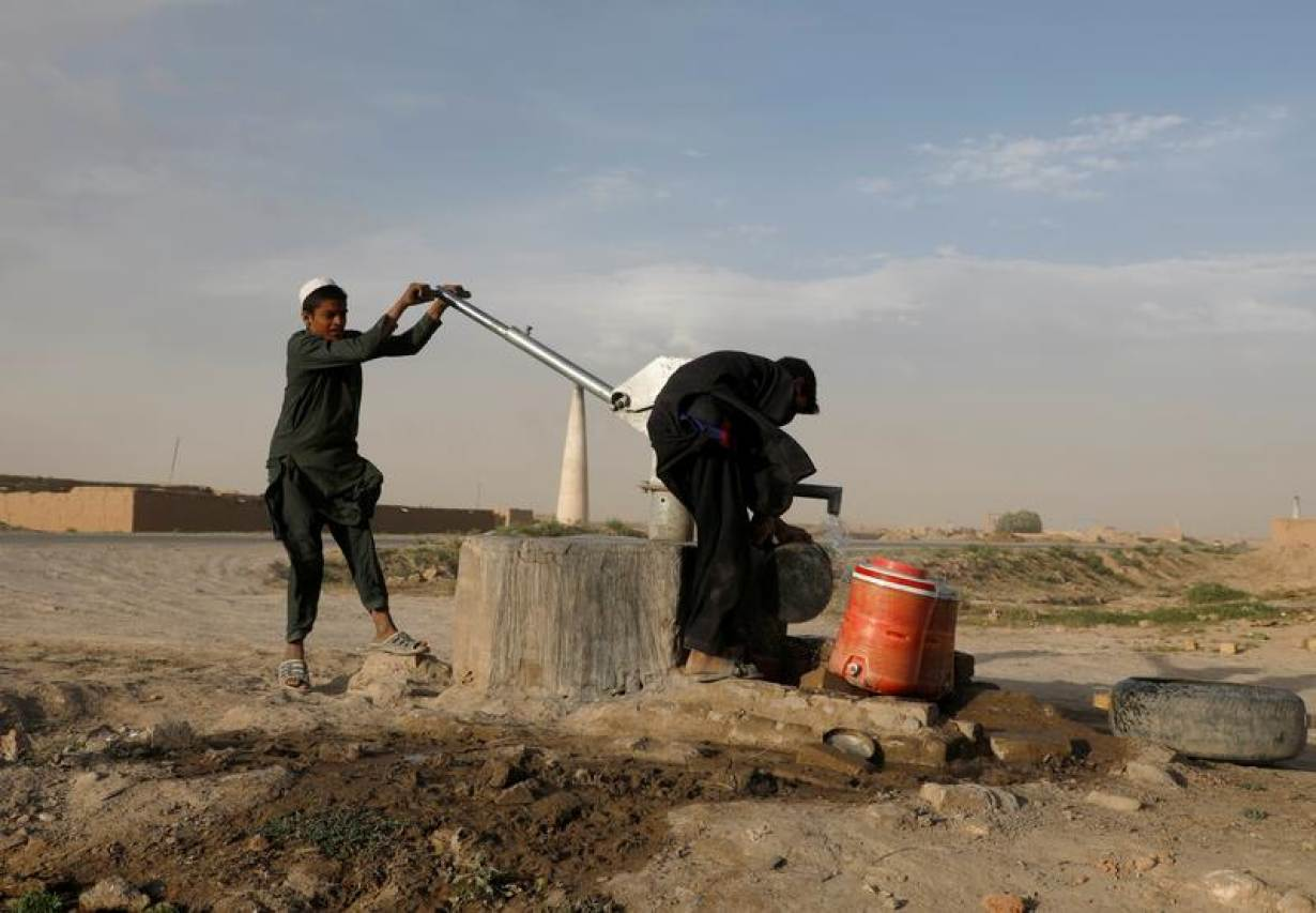 FILE PHOTO: Boys extract water from a public water pump on the outskirts of Kabul, Afghanistan, June11, 2019. | REUTERS/Omar Sobhani