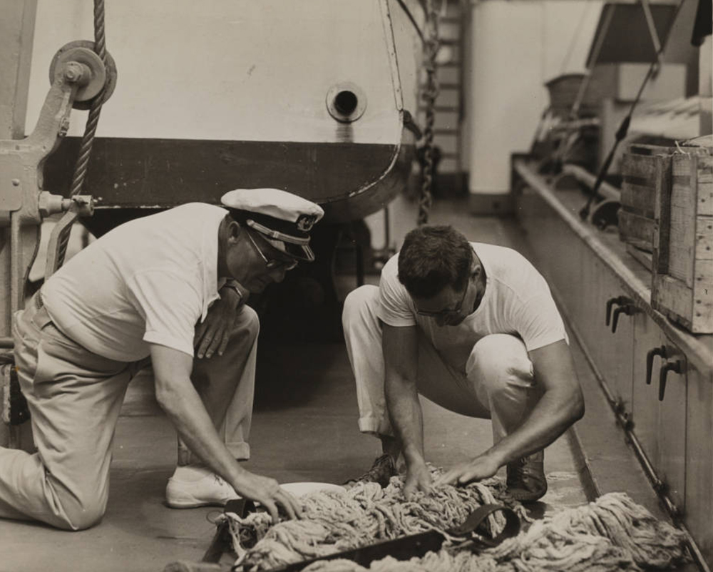 Captain Hancock & Dr. Schmitt on deck sorting a dredge haul, Velero III, 1933 | Allan Hancock Foundation Collection, USC Libraries