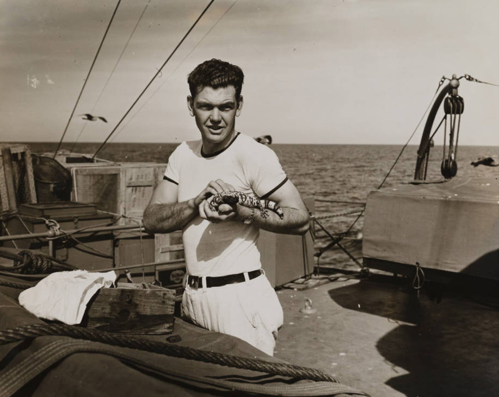Man with lizard, Velero III, 1931-1941| Allan Hancock Foundation Collection, USC Libraries