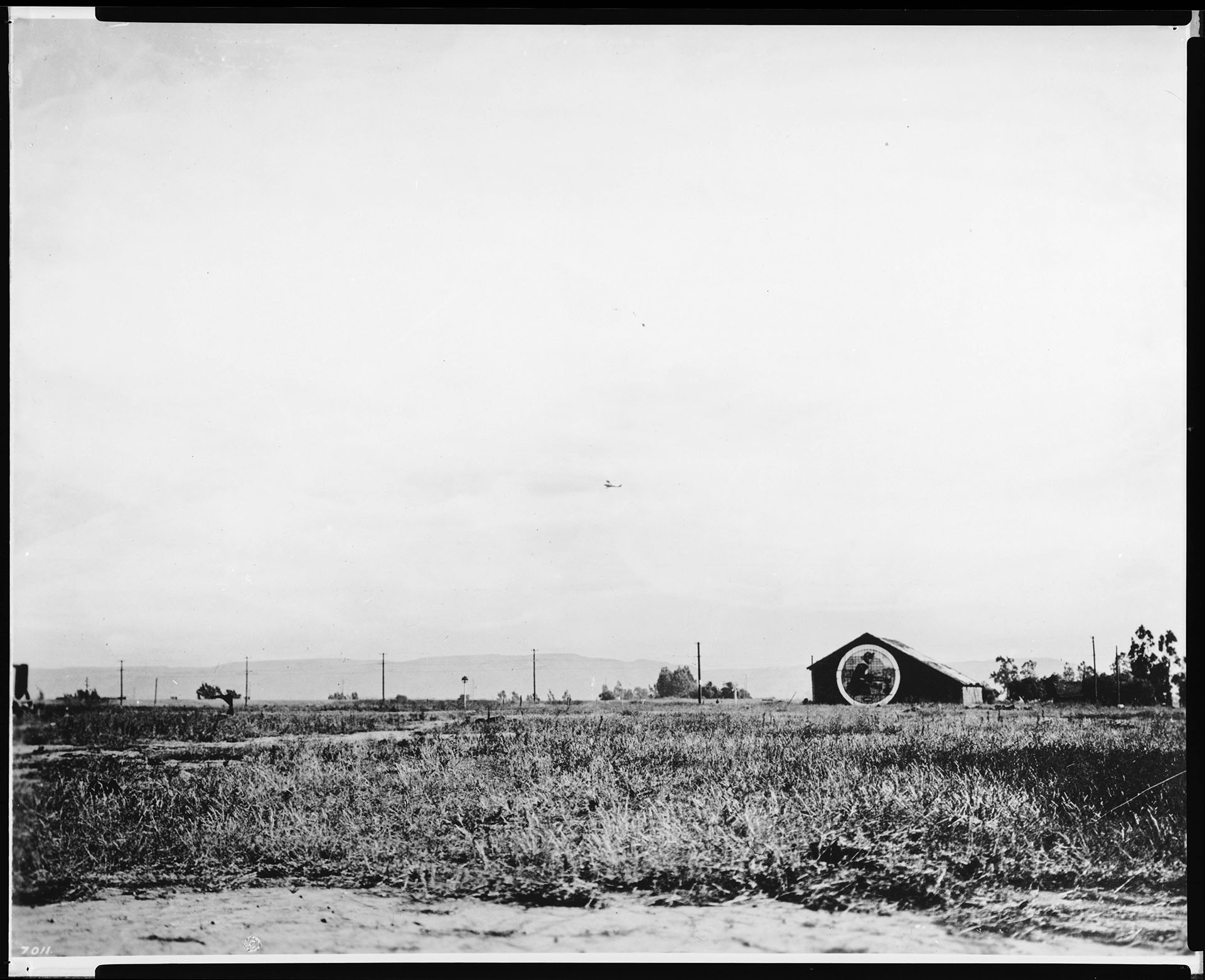 View of Hollywood south of Wilshire Boulevard and Fairfax Avenue looking west, (possibly at Rogers Airport), ca.1920