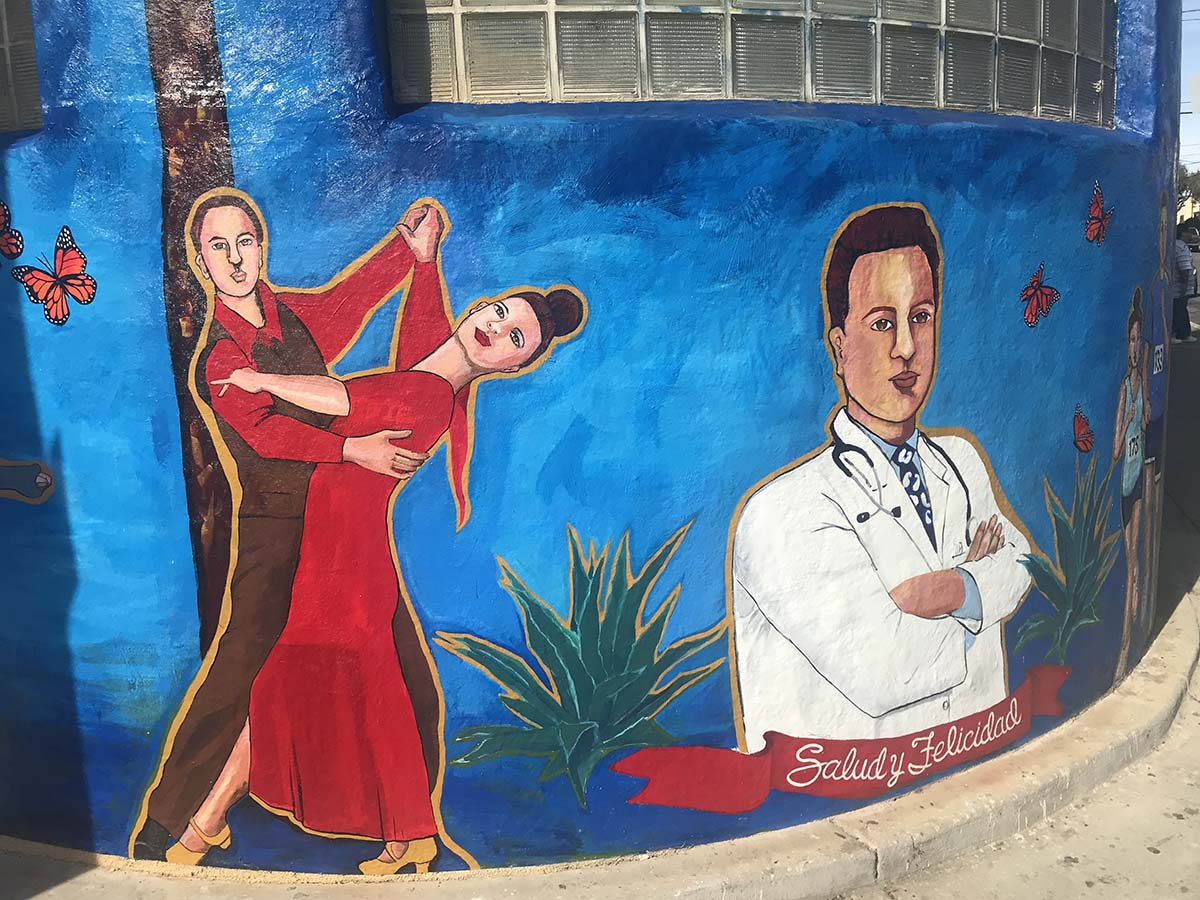A mural in progress on an AltaMed clinic exterior by Yolanda Gonzalez  | Courtesy of AltaMed