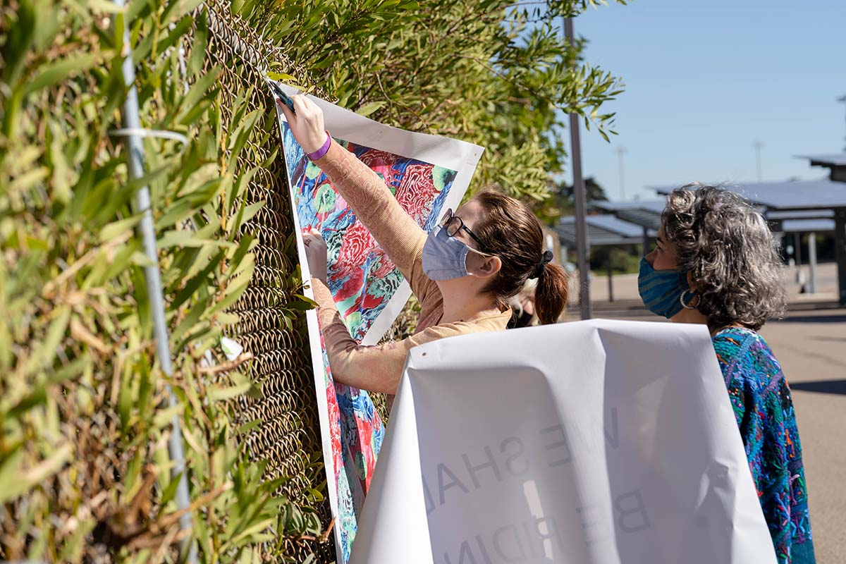 """People installing art at the """"Mesa College Drive-In: An Outdoor Art Exhibition""""   San Diego Mesa College"""