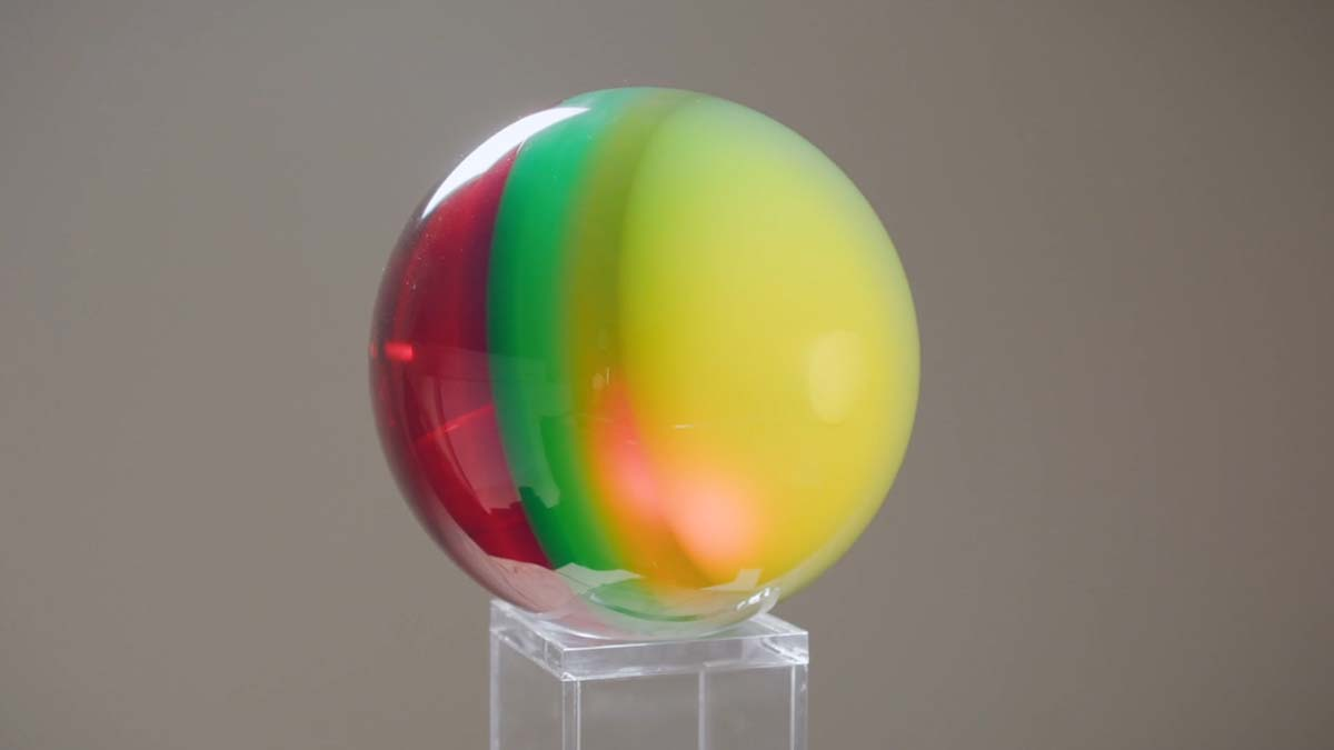 """A multi-colored sphere by Helen Pashgian. 