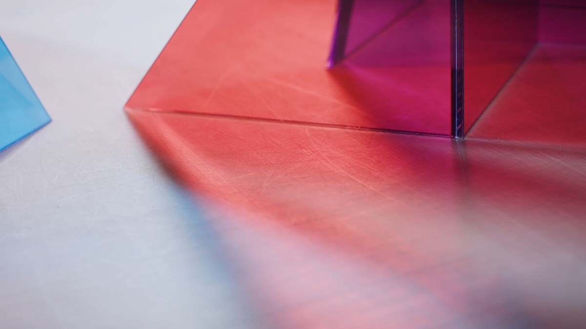 """Light goes through one of Larry Bell's models for his Light and Space artwork 