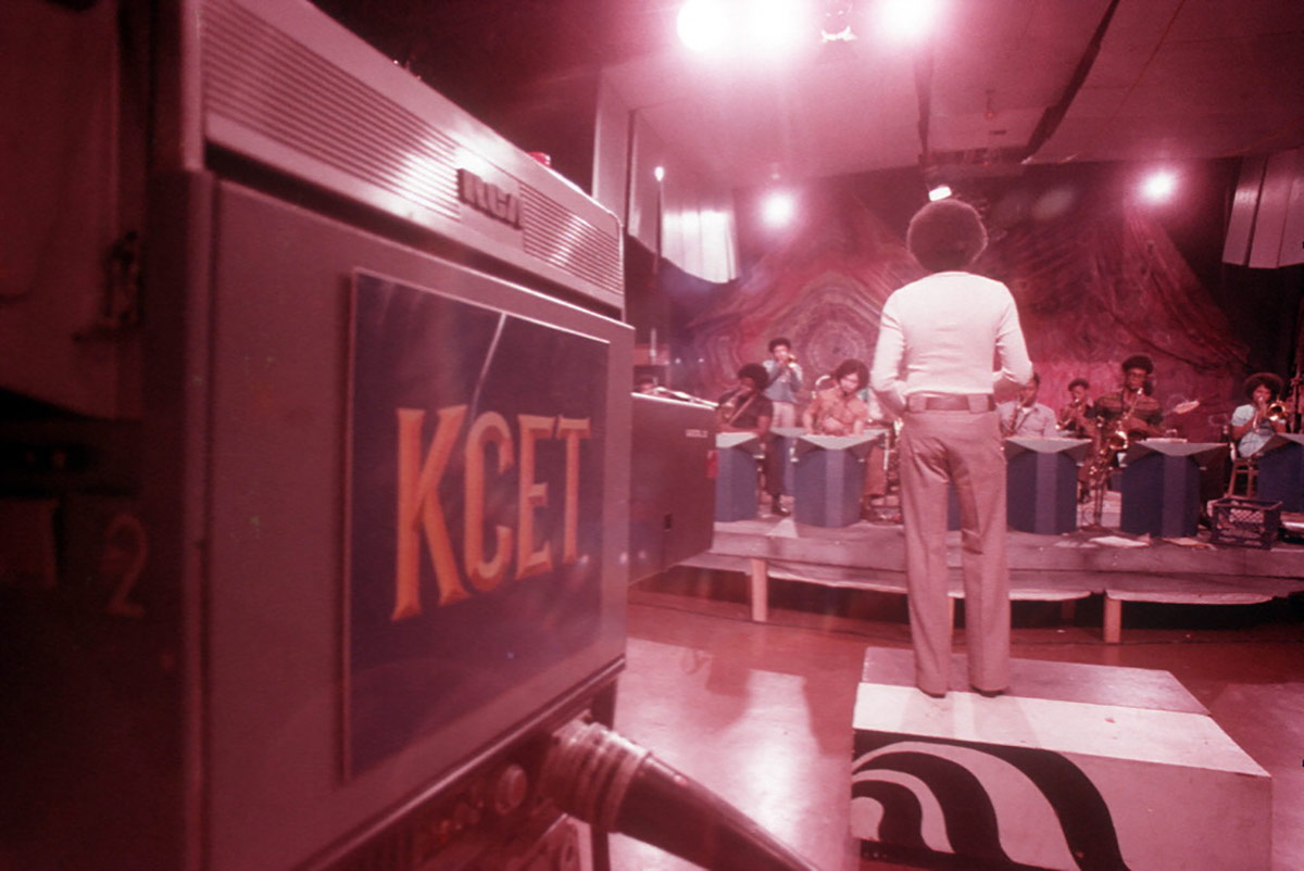 KCET records a performance of the CAA orchestra at the Arena. | Willie Ford, Jr. and the Compton Communicative Arts Academy Collection, Special Collections and Archives, John F. Kennedy Memorial Library, California State University, Los Angeles