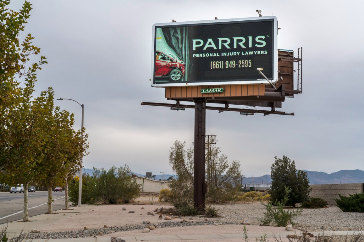 One of several billboards located across Antelope Valley advertising Lancaster Mayor R. Rex Parris' namesake law firm that specializes in personal injury law. | Kim Stringfellow © 2017