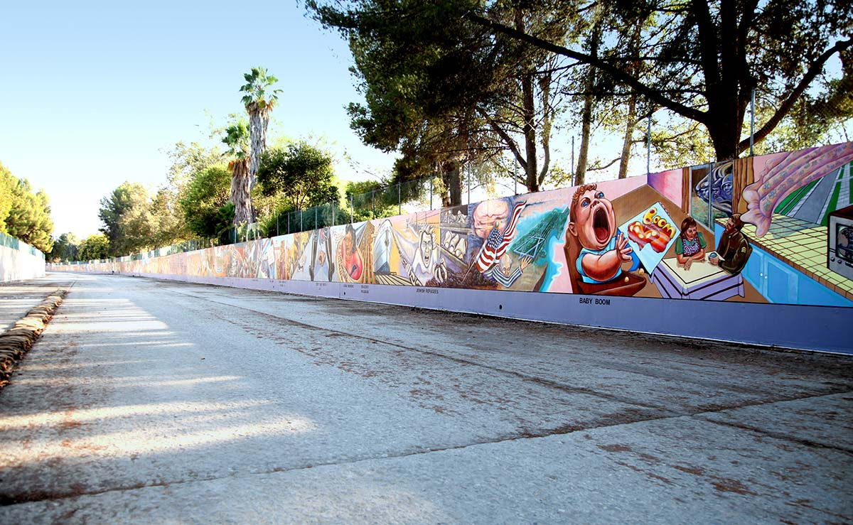 """A view of the 13' x 2,400' """"Great Wall"""" mural located in the Tujunga Wash, a flood control channel. It depicts a multi-cultural history of California from prehistory through to the 1950s. 