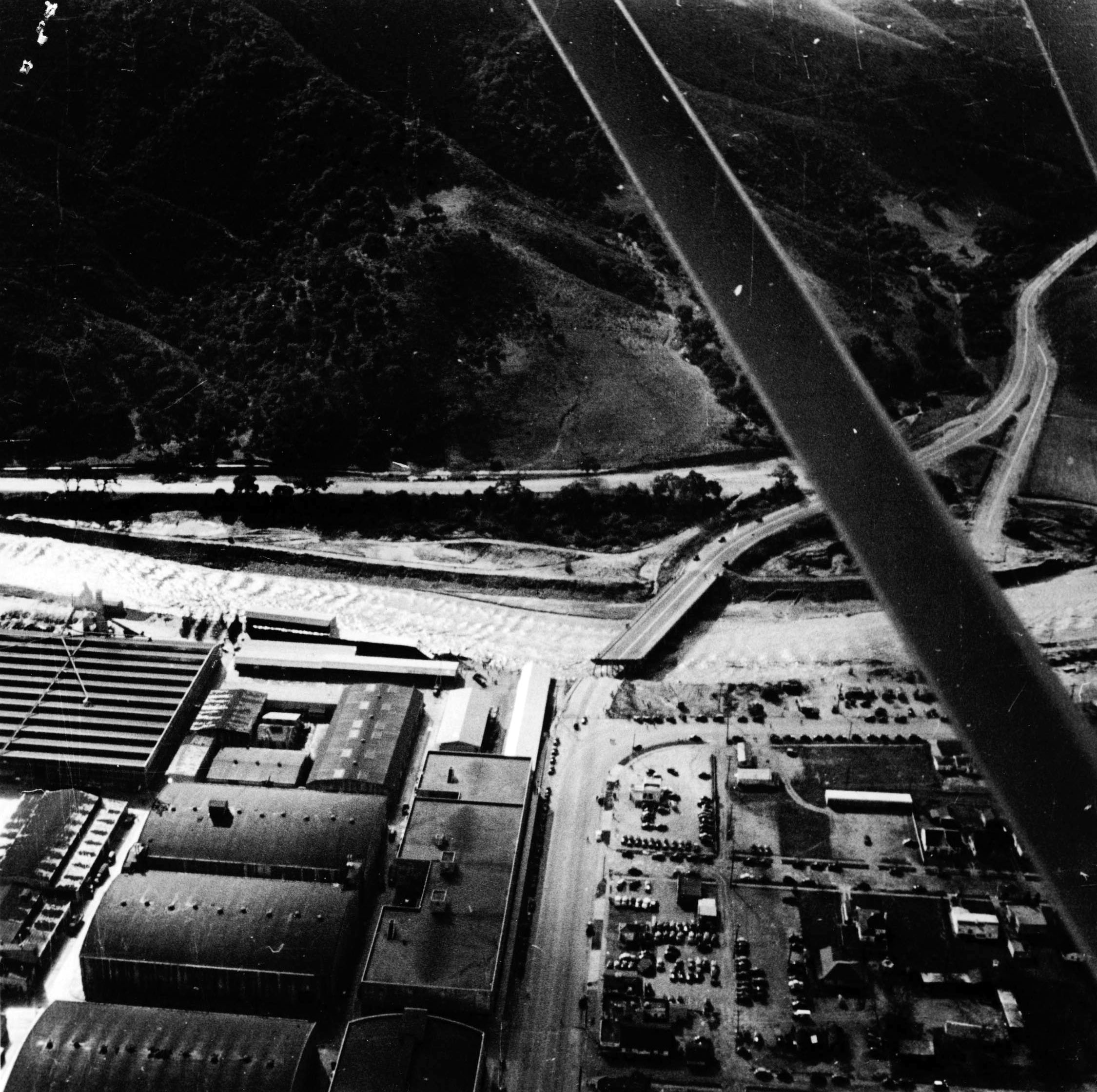 Aerial view of the collapsed Barham Bridge at Warner Bros. studios in Burbank after the flood of 1938
