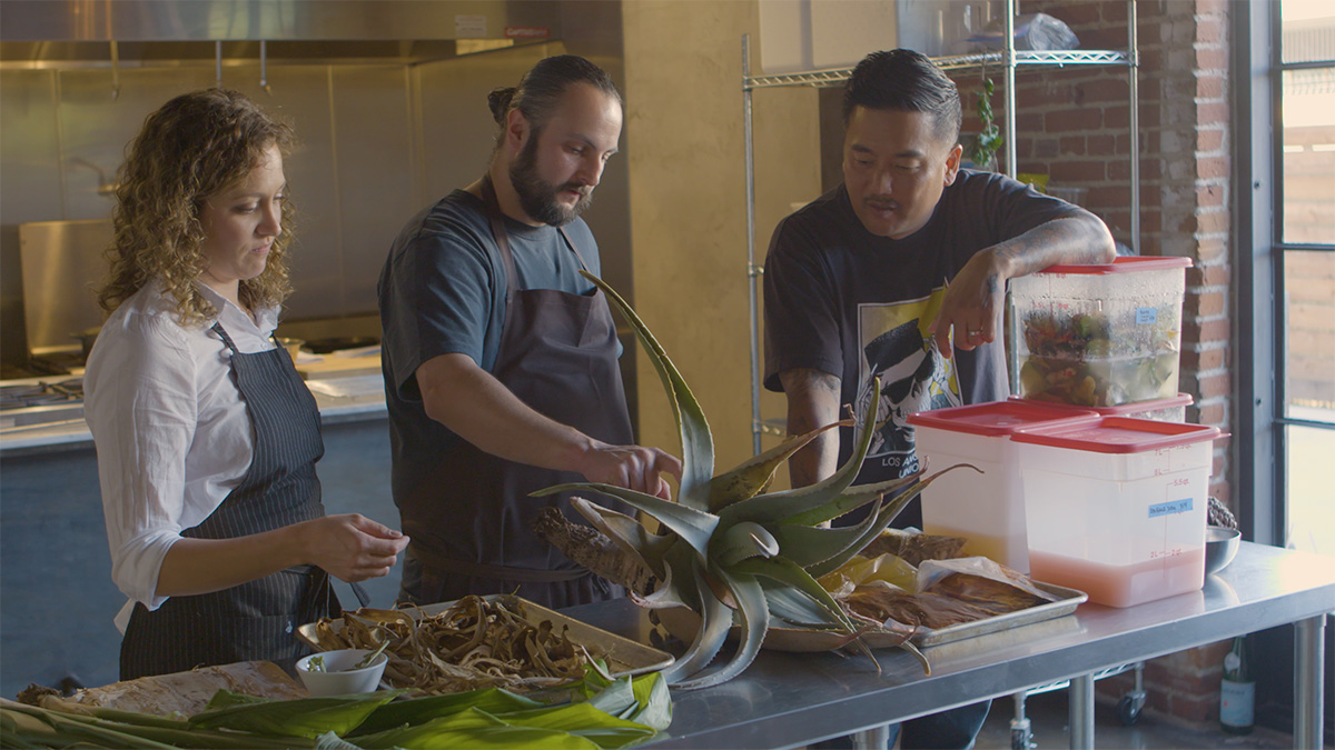 "Henry Fischer and Anna Rose Hopkins of Hank and Bean show Roy Choi their menu | Still from ""Broken Bread"""