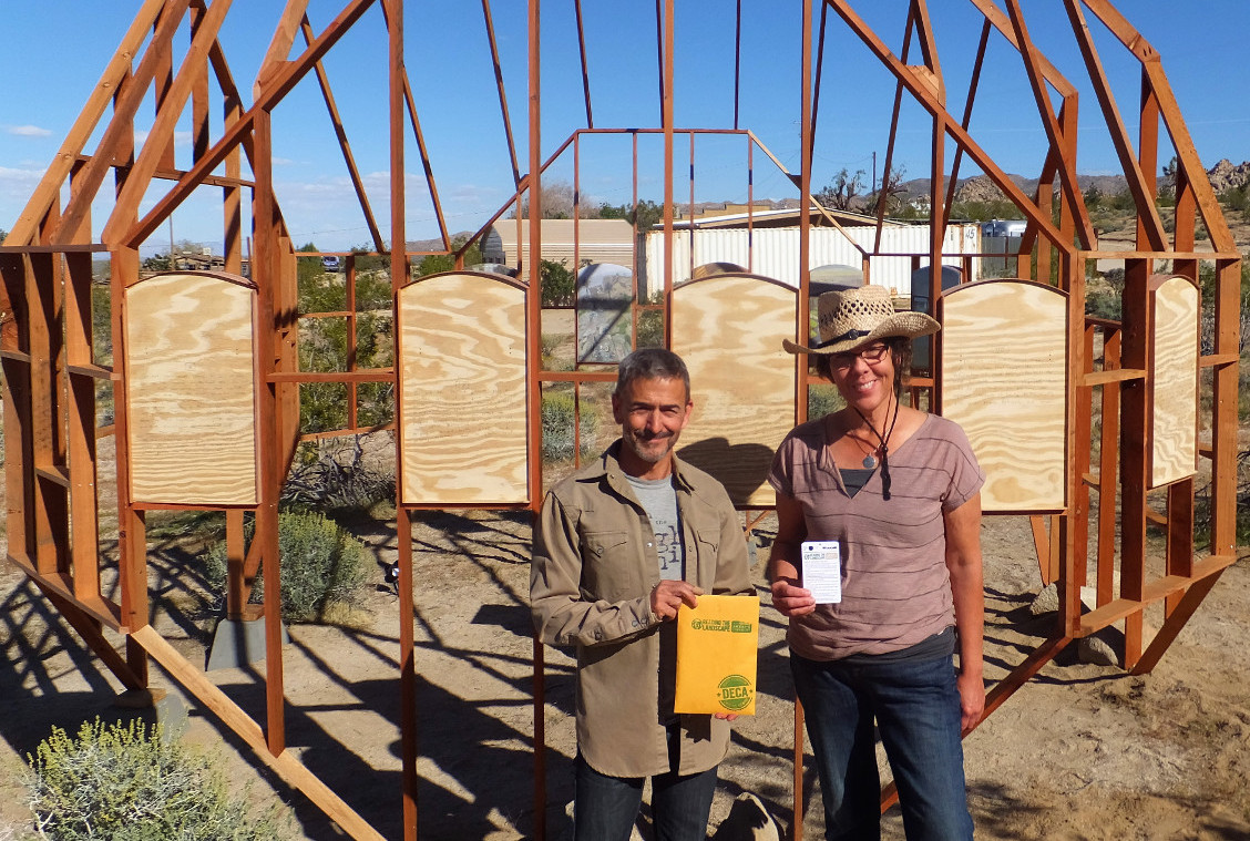 """Bernard Leibov and Danielle Segura hold """"Reading the Landscape"""" resources"""