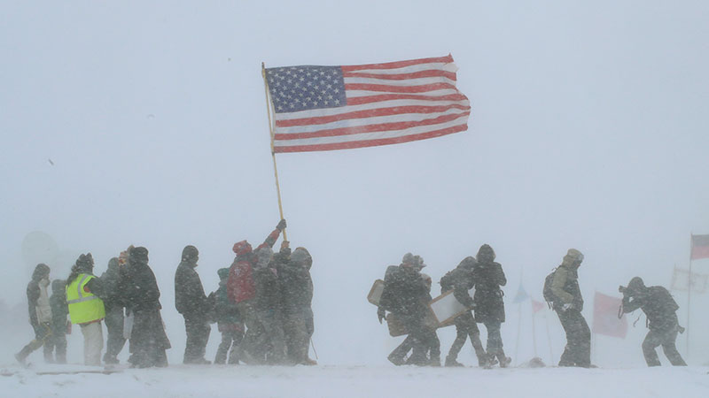Veteran supporters of the Sioux march through blizzard
